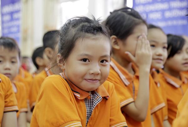 Trẻ em Việt Nam dần được cung cấp đầy đủ dinh dưỡng hơn để phát triển thể chất. Ảnh:Anh Quân