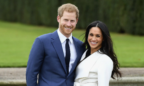 Hoàng tử Harry bên vợ chưa cưới. Ảnh: Standard.