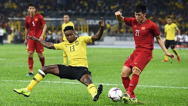 Sumareh (số 13) là cầu thủ đầu tiên không có gốc gác Malaysia thi đấu cho đội tuyển nước này. Ảnh: Đức Đồng